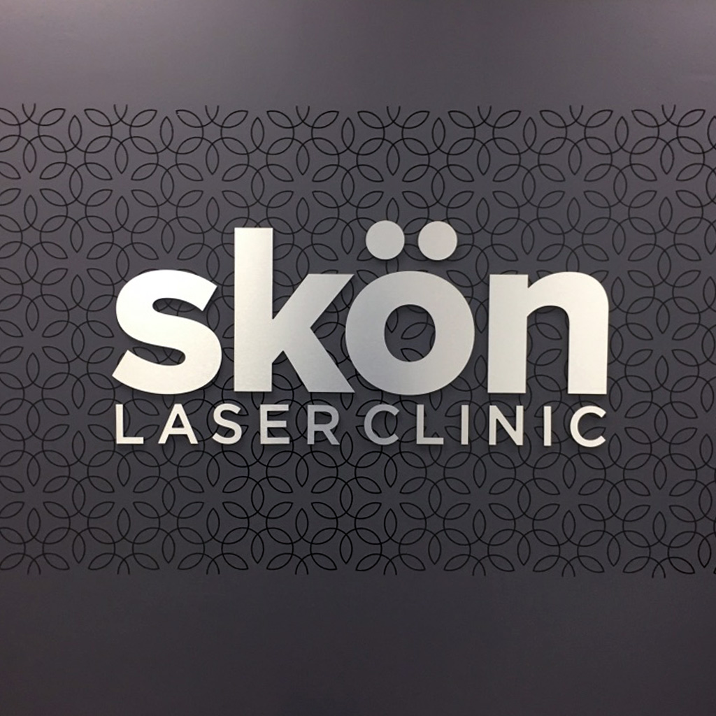 interior brand signage, interior wall signage, Skon Laser Clinic Brand Design by BANG! creative strategy by design